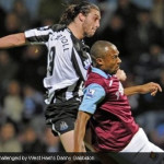 Andy Carroll challenged by West Ham's Danny Gabbidon