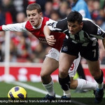 Joey Barton keeping the ball away from Arsenal's Jack Wilshere