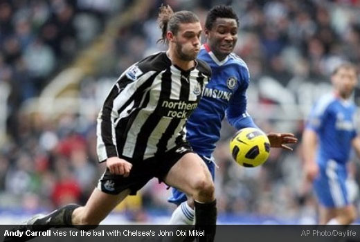 Andy Carroll vies for the ball with Chelsea's John Obi Mikel