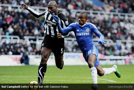 Sol Campbell battles for the ball with Salomon Kalou