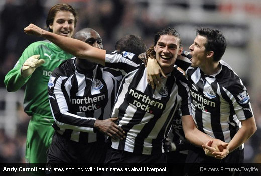 Andy Carroll celebrates scoring with teammates against Liverpool
