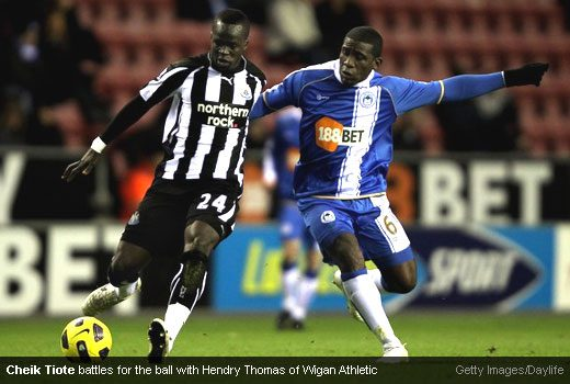 Cheik Tiote battles for the ball with Hendry Thomas of Wigan Athletic