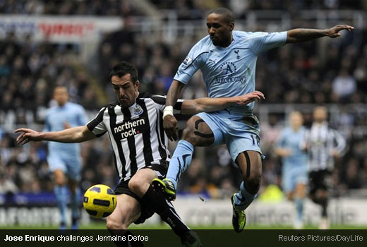 Jose Enrique challenges Jermaine Defoe to the ball