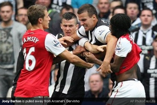 Joey Barton is pulled away from Arsenal's Gervinho [Magpies Zone/AP Photo/DayLife]