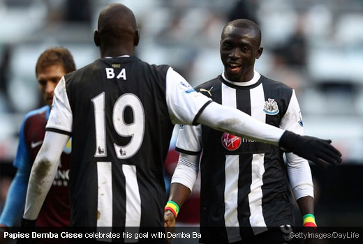 Papiss Demba Cisse celebrates the win against Aston Villa with Demba Ba