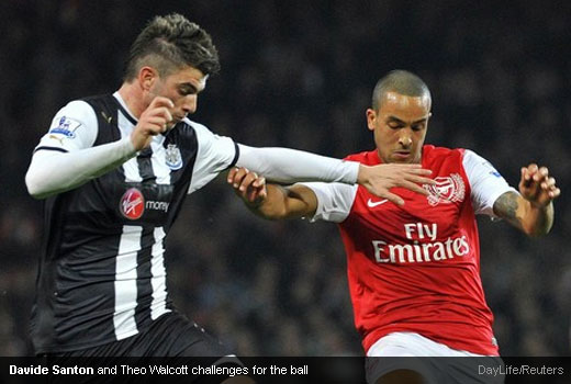 Davide Santon and Theo Walcott challenges for the ball