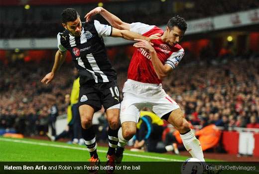 Hatem Ben Arfa and Robin van Persie battle for the ball