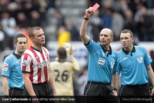 Lee Cattermole is sent-off by referee Mike Dean