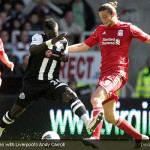 Cheik Tiote vies with Liverpool's Andy Carroll