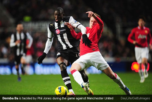 Demba Ba is tackled by Phil Jones during the game against Manchester United