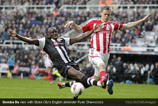 Demba Ba vies with Stoke City's English defender Ryan Shawcross