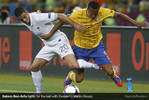 Hatem Ben Arfa fights for the ball with Sweden's Martin Olsson