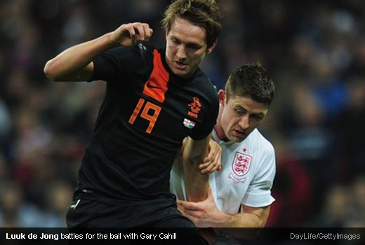 Luuk de Jong battles for the ball with Gary Cahill