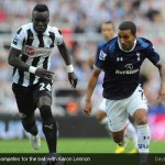 Cheick Tiote competes for the ball with Aaron Lennon