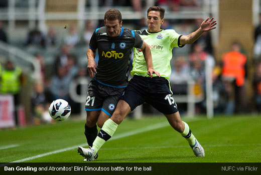 Dan Gosling and Atromitos' Elini Dimoutsos battle for the ball