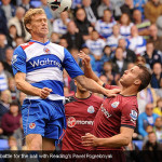 Steven Taylor battle for the ball with Reading's Pavel Pogrebnyak