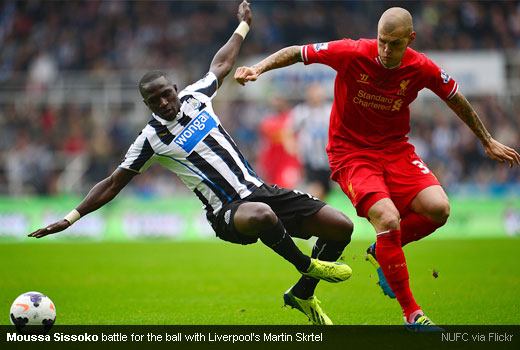 Moussa Sissoko battle for the ball with Liverpool's Martin Skrtel
