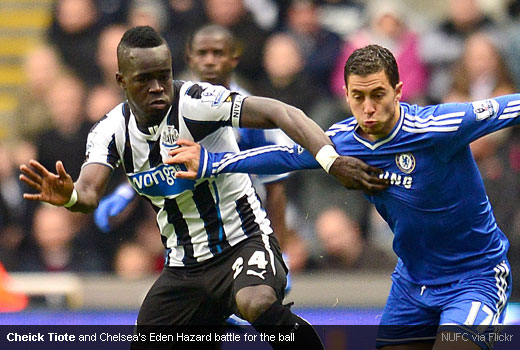 Cheick Tiote and Chelsea's Eden Hazard battle for the ball