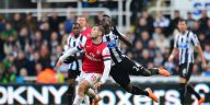 Cheick Tiote battle for the ball with Arsenal's Jack Wilshere