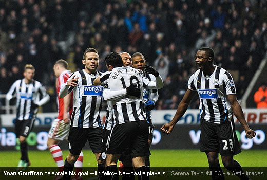 Yoan Gouffran celebrate his goal with fellow Newcastle players