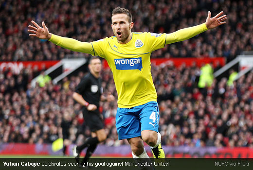 Yohan Cabaye celebrates scoring his goal against Manchester United